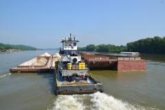 The M/V Wayne C transporting gypsum barges down the Ohio River
