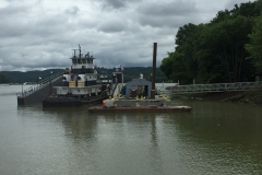 A tug being put on dry dock at C&B's Hebron, KY facility