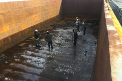 C&B associates cleaning the bottom of a barge at its Hebron, KY facility