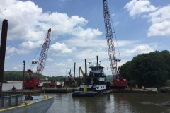 C&B's mobile cranes on work barges, assisting C&B's dry dock facility