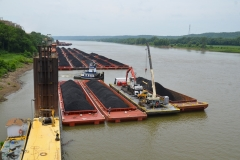 The M/V JL BRADEN performing harbor services at a coal plant while a C&B work barge prepares to reclaim coal
