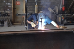 C&B associate welding as part of barge repair work